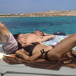 Couple relaxing on deck in koufonissi